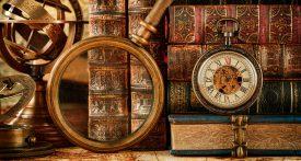 loupe, montre à gousset et vieux livres